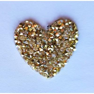Aplicacion corazón con pedrería dorada